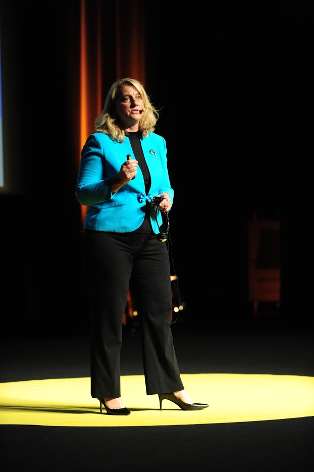 Image of Jamie Burton speaking on stage
